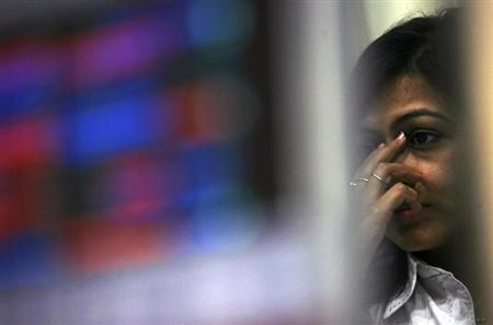 A broker reacts while trading at a stock brokerage in Mumbai February 26, 2010. REUTERS/Arko Datta/Files