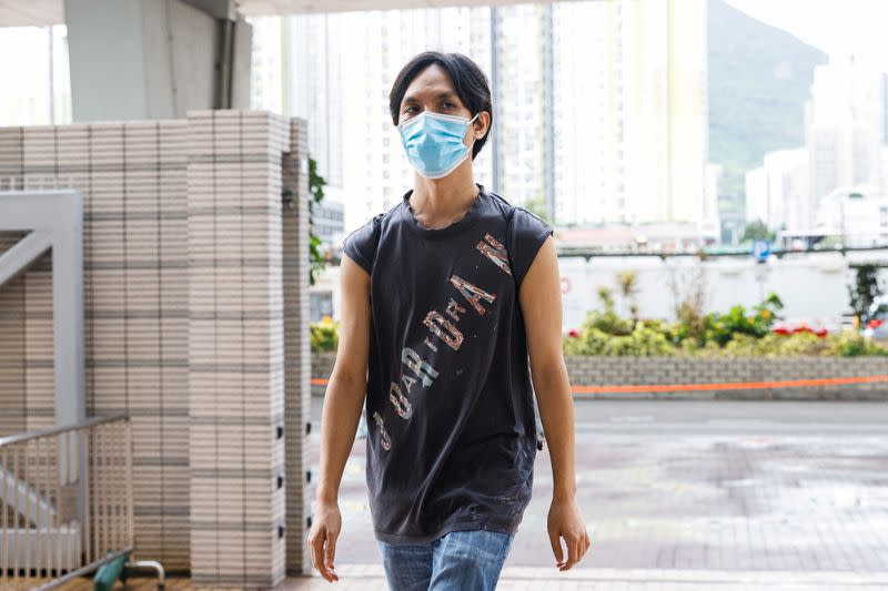 Pro-democracy activist Hendick Lui Chi Hang, one of the 47 pro-democracy activists charged with conspiracy to commit subversion under the national security law, arrives West Kowloon Magistrates's Courts building, in Hong Kong
