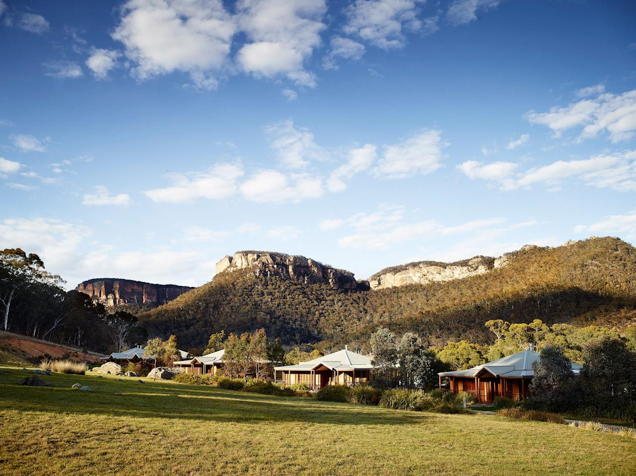 """<p><strong>How did it strike you on arrival?</strong><br> Epic escarpments and dramatic valleys make this luxe wilderness retreat in the <a href=""""https://www.cntraveler.com/activities/sydney/blue-mountains-national-park?mbid=synd_yahoo_rss"""">Greater Blue Mountains</a> feel like you've stepped onto the set of <em>Jurassic Park.</em> A three hours' drive west of Sydney, the hotel is part of a 7,000-acre private conservation reserve—so the only other guests you'll find yourself sharing views with are the wandering kangaroos, wallabies, and wombats who call the place home.</p> <p><strong>Nice. What's the crowd like?</strong><br> This just-remote-enough wildlife escape lures a smart crowd of international guests and well-groomed locals (all of whom are togged up in R.M. Williams and Driza-Bone) who are keen to experience an unforgettable Australian safari.</p> <p><strong>The good stuff: Tell us about your room.</strong><br> Each of the 40 freestanding stone-and-wood villas frames jaw-dropping views of the surrounding landscape. Single-bed Heritage Villas with double-sided fireplaces, private heated lap pool, and verandas tend to appeal most to couples, while two-bedroom Wollemi Villas work best if you've brought the whole family.</p> <p><strong>How about the little things, like mini bar, or shower goodies. Any of that find its way into your suitcase?</strong><br> With plump beds, double vanities, spacious bathrooms and sky-lit showers, rooms have the key stuff more than covered—but the small details are thoughtful, too, from carved wooden wombat ornaments, to binoculars for birdspotting and books devoted to naturalist Charles Darwin's 19th-century visits to Wolgan Valley. Villa rentals also include complementary mountain bikes, so you can explore independently. Free WiFi makes up for the lack of mobile phone reception.</p> <p><strong>Room service: Worth it?</strong><br> You definitely won't go hungry—this all-inclusive resort puts up three gourmet meals daily, with non-al"""