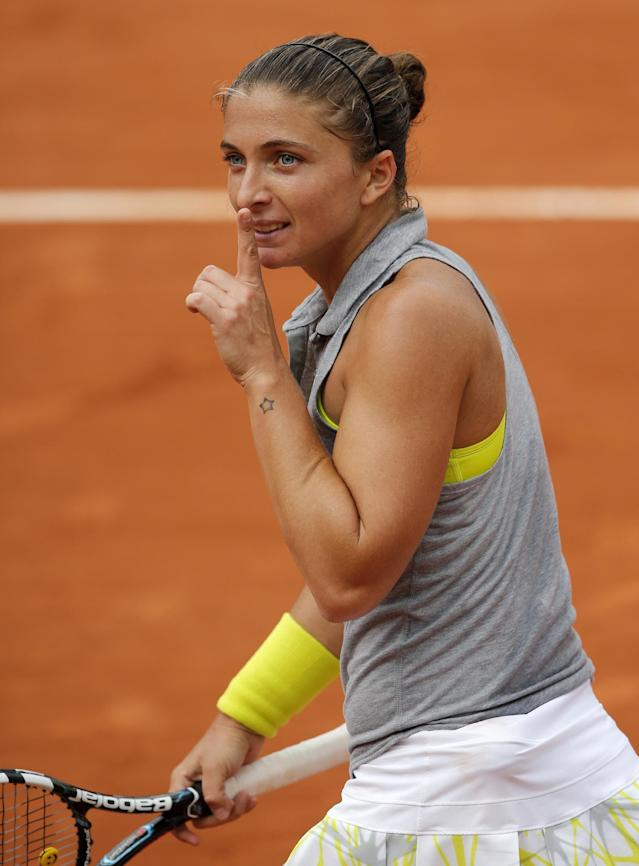Italy's Sara Errani has her finger on her mouth after defeating Serbia's Jelena Jankovic during their fourth round match of the French Open tennis tournament at the Roland Garros stadium, in Paris, France, Monday, June 2, 2014. (AP Photo/David Vincent)