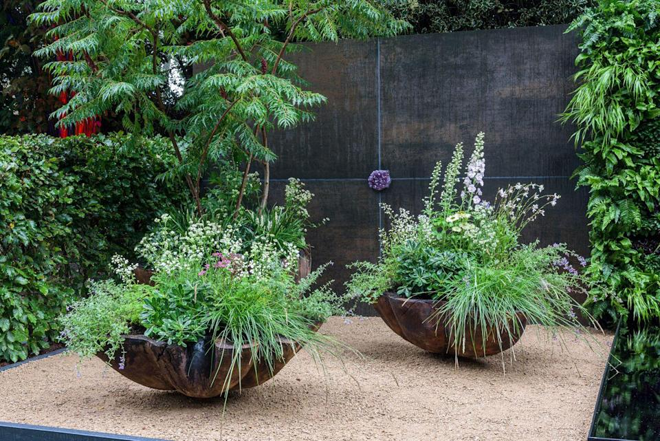<p>The final Container Garden is this beautiful space designed by Anna Dabrowska-Jaudi. With two contrasting planting schemes, Anna has used the garden to translate human emotions. We're big fans of the exquisite trio of seashell inspired pots crafted in solid oak. </p>