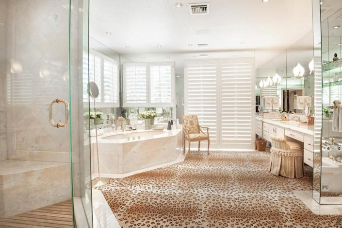 """<p>This master bath – one of a pair – has a steam shower with French doors, plenty of mirrors and light, and a dressing table. (All photos via <a href=""""http://bit.ly/1OjQdjg"""" rel=""""nofollow noopener"""" target=""""_blank"""" data-ylk=""""slk:Concierge Auctions listing"""" class=""""link rapid-noclick-resp"""">Concierge Auctions listing</a>)<br></p>"""