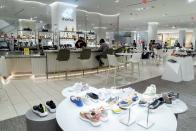 A shopper sits at the Shoe Bar in a shoe department at the Nordstrom NYC Flagship store, in New York, Wednesday, July 14, 2021. Like many of its peers, venerable department store chain Nordstrom is having a tough time keeping pace with customer demand for new clothes because of supply issues. (AP Photo/Richard Drew)