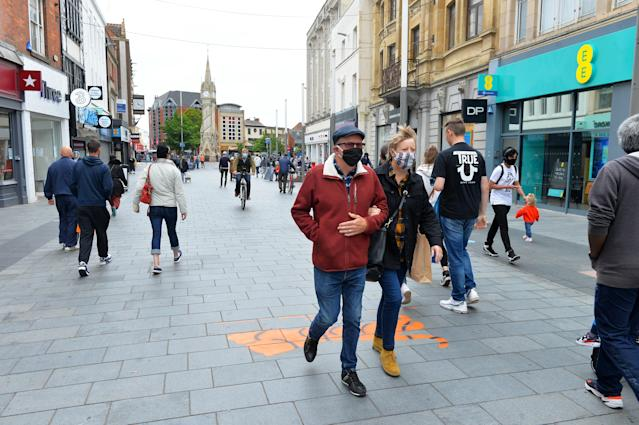 People wear face masks on Gallowtree Gate in Leicester city centre, as a localised lockdown is introduced there. (PA)