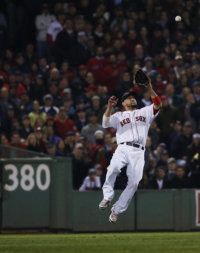 Boston Red Sox right fielder Shane Victorino catches a fly ball by St. Louis Cardinals catcher Yadier Molina during the eighth inning of Game 6 of baseball's World Series Wednesday, Oct. 30, 2013, in Boston. (AP Photo/Elise Amendola)