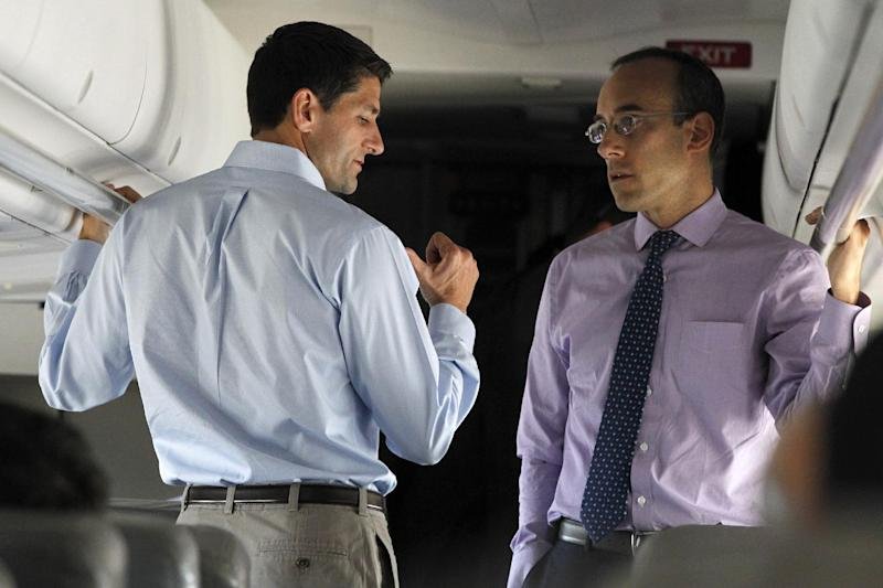 Republican vice presidential candidate, Rep. Paul Ryan, R-Wis. speaks to senior adviser Dan Senor on board the campaign charter flight en route to Port Columbus International Airport, Friday, Oct. 12, 2012.  (AP Photo/Mary Altaffer)