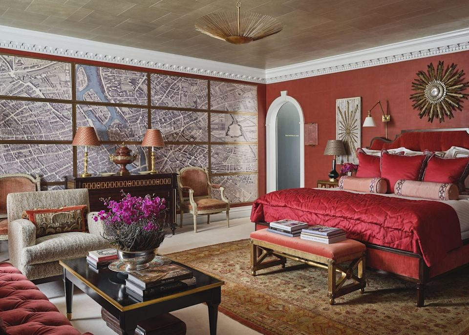 """<p>While people usually look away from doing an all-red or russet-colored room, ELLE DECOR A-List designer <a href=""""https://alexahampton.com/interiors"""" rel=""""nofollow noopener"""" target=""""_blank"""" data-ylk=""""slk:Alexa Hampton"""" class=""""link rapid-noclick-resp"""">Alexa Hampton</a> embraced the idea. In """"La Chambre Rouge,"""" luscious red walls, bedding, and furnishings adorn the whole room. The enlarged <a href=""""https://www.graciestudio.com/"""" rel=""""nofollow noopener"""" target=""""_blank"""" data-ylk=""""slk:Gracie Studio"""" class=""""link rapid-noclick-resp"""">Gracie Studio</a> map of the City of Light pulls the entire scheme together with just the right dose of <em>je ne sais quoi. </em><br></p>"""
