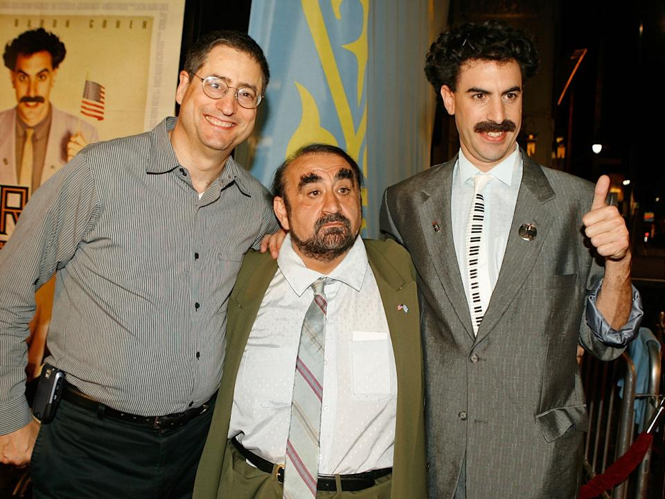 Ken Davitian (centre) and Sacha Baron Cohen (right) alongside Fox Filmed Entertainment Chairman Tom Rothman in 2006Getty Images