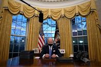 On day one, US President Joe Biden wore a mask in the Oval Office