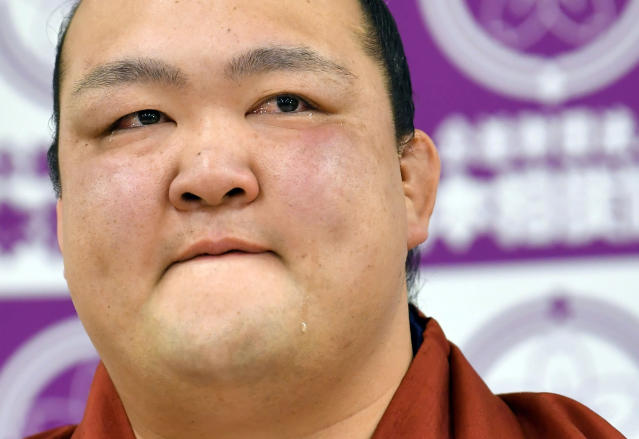 Grand champion Kisenosato attends a press conference to announce his retirement in Tokyo Wednesday, Jan. 16, 2019. Kisenosato, the only Japanese wrestler at sumo's highest rank, has decided to retire after three straight losses at the New Year Grand Sumo Tournament. (Yohei Nishimura/Kyodo News via AP)