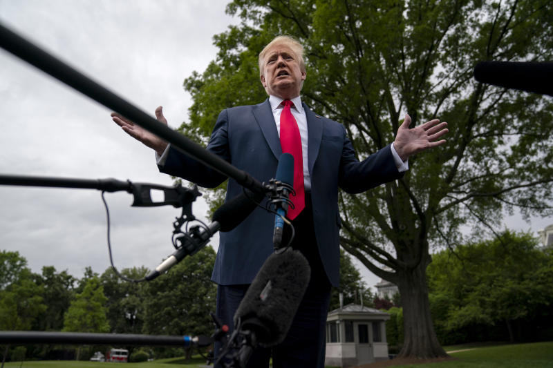 President Donald Trump talks to reporters before departing the White House for a trip to Michigan, Thursday, May 21, 2020, in Washington. (Evan Vucci/AP)