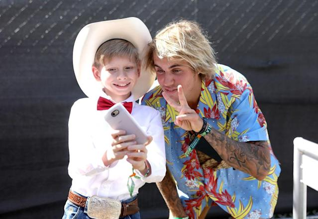 "<p>Internet sensation meet … internet sensation. The Biebs was kind enough to selfie with the Walmart Yodeling Boy, who performed on April 13. Fitting that JB flashed a peace sign because he also <a href=""https://www.yahoo.com/entertainment/justin-bieber-allegedly-just-punched-190400827.html"" data-ylk=""slk:broke up a big fight at the fest;outcm:mb_qualified_link;_E:mb_qualified_link"" class=""link rapid-noclick-resp newsroom-embed-article"">broke up a big fight at the fest</a>, according to reports. A man, who may have been under the influence of drugs, attacked a woman, and Bieber intervened, knocking him out. (Photo: Natt Lim/Getty Images for Coachella) </p>"