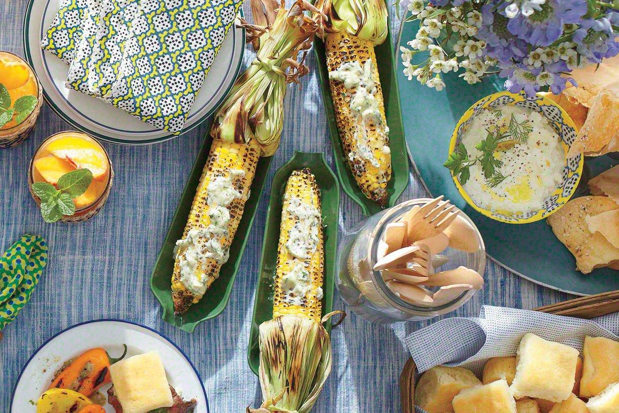 "<p><strong>Recipe:</strong> <a href=""http://www.myrecipes.com/recipe/charred-corn-50400000128260/"" target=""_blank""><strong>Charred Corn with Garlic-Herb Butter</strong></a></p> <p>Use the husks as handles by pulling them back and tying the ends with kitchen string. Soak in cold water at least 10 minutes before grilling to prevent burning.</p>"