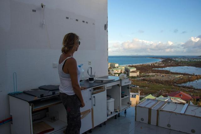 <p>A photo taken on September 17, 2017 shows a woman standing in a room without a roof or windows at the Alizea residence in Mont Vernon, on the French Caribbean island of Saint Martin, after the passage of Hurricane Irma. (Photo: Helene Valenzuela/AFP/Getty Images) </p>