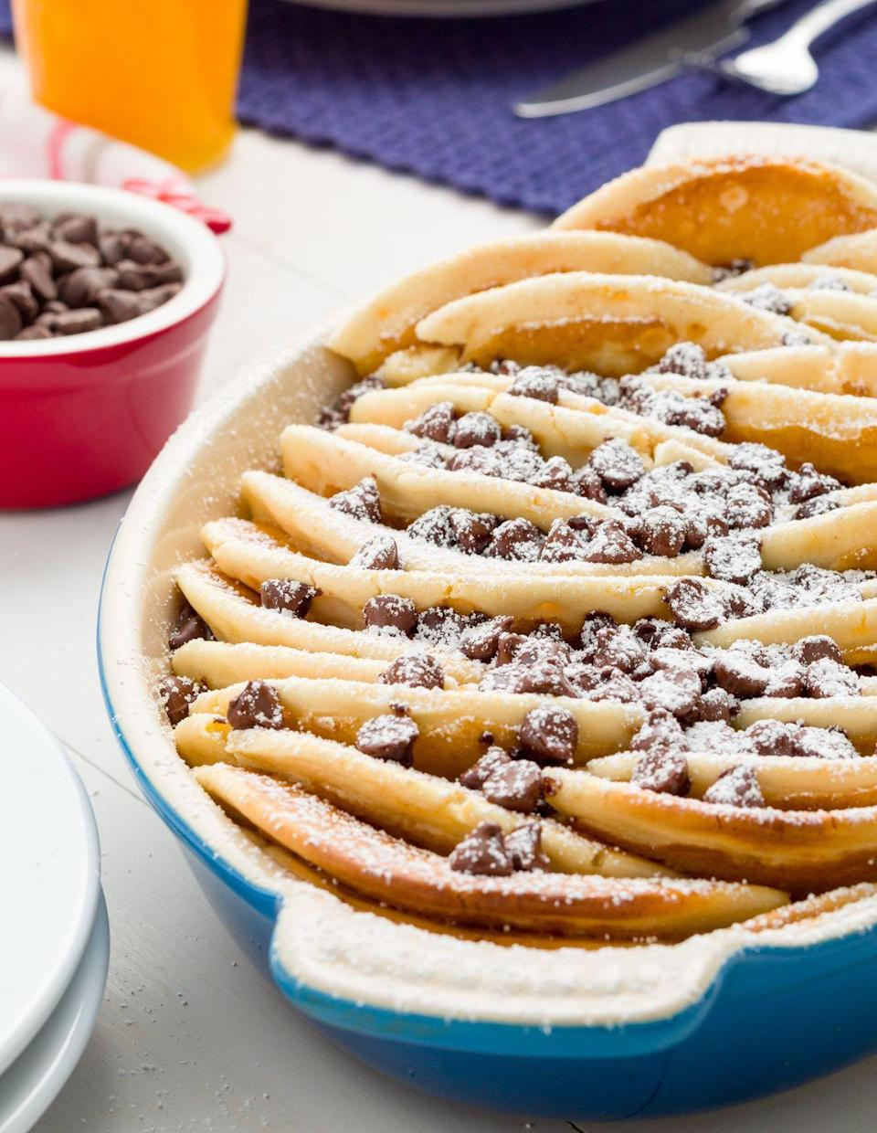 """<p> Layers of fluffy pancakes, sprinkled with chocolate chips, and showered in powdered sugar.</p><p>Get the recipe from <a href=""""https://www.delish.com/cooking/recipe-ideas/recipes/a45036/chocolate-chip-pancake-casserole-recipe/"""" rel=""""nofollow noopener"""" target=""""_blank"""" data-ylk=""""slk:Delish"""" class=""""link rapid-noclick-resp"""">Delish</a>.</p>"""