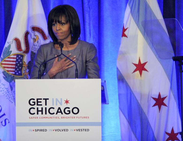 First lady Michelle Obama speaks about 15 year-old Hadiya Pendleton who was shot and killed on the south side of Chicago earlier this year, during a luncheon at the Chicago Hilton in Chicago, Wednesday, April 10, 2013. The first lady is visiting Chicago for a discussion with Chicago Mayor Rahm Emanuel and civic leaders on ways to combat youth violence. (AP Photo/Paul Beaty)