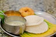 <p><b>Idli – Sambar</b></p><p>The humble idli and sambar is said to be one of the healthiest and balanced meal. It is a part of typical South Indian breakfast and is served along with sambar and a variety of chutneys. The carbohydrates in rice, protein in lentils and the nutrients from vegetables and spices added in the sambar makes this a perfectly balanced meal. Hot, fluffy idlis with tasty sambar is the perfect way to satisfy the morning hunger. Mini idlis dunked in hot sambar, pepper idli, chilli idli, masala idli are some variants that are popular among one and all.</p>