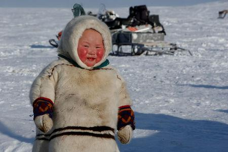 """A child from the indigenous community """"Yamb To"""" (Long Lake) is seen at a reindeer camping ground, about 450 km northeast of Naryan-Mar, in Nenets Autonomous District, Russia, March 1, 2018. REUTERS/Sergei Karpukhin"""