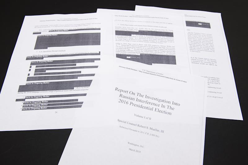 A few pages of special counsel Robert Mueller's report on Russian interference in the 2016 election. | Tom Williams—Newscom via ZUMA Press