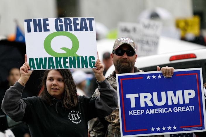 Q-Anon conspiracy theorists hold signs during a protest at the State Capitol in Salem, Ore., on May 2. (John Rudoff/Anadolu Agency via Getty Images)