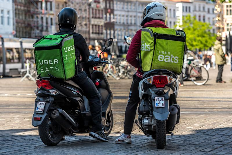 An Uber Eats user was called out for cancelling their order at the eleventh hour. Pictured are two delivery drivers on their motorbikes.