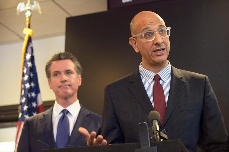 California Health and Human Services Agency Secretary Dr. Mark Ghaly speaks at a news conference in Sacramento with Gov. Gavin Newsom.
