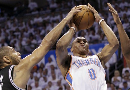 Oklahoma City Thunder point guard Russell Westbrook (0) is defended by San Antonio Spurs center Tim Duncan, left, during the first half of Game 6 in the NBA basketball Western Conference finals, Wednesday, June 6, 2012, in Oklahoma City. (AP Photo/Sue Ogrocki)