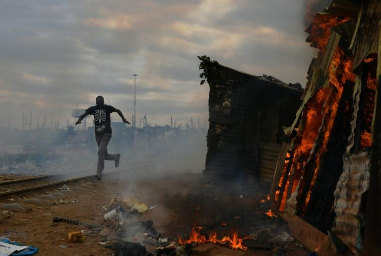 Protesters burnt shacks to the ground in a Nairobi slum in violent demonstrations against Kenya's presidential election result