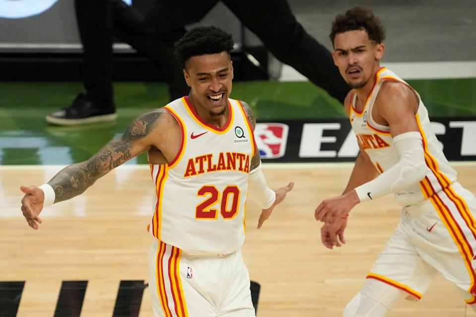 John Collins (20) and Trae Young have developed great on-court chemistry, which has helped the Hawks reach the Eastern Conference finals.