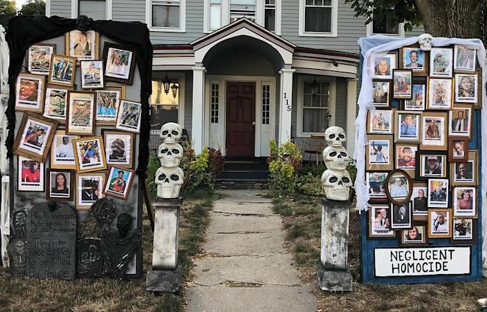 "The ""Halloween House"" displays photos of people who have died from COVID-19 or at the hands of police. (Photo: Matt Warshauer)"