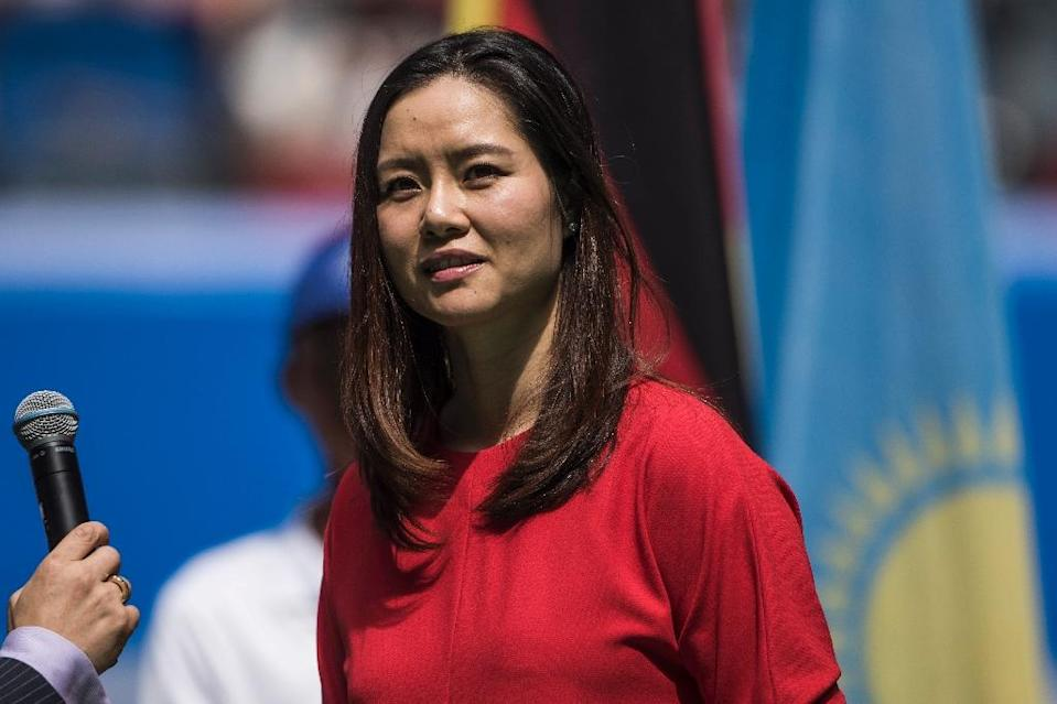 Former tennis star Li Na speaks to the public during the Wuhan Open opening ceremony in China's Hubei province on September 27, 2015 (AFP Photo/Fred Dufour)