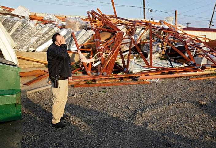 Justin Sloggett views the damage to his parents' business, Saving Place Rustic Furniture and Mattress, in Sapulpa, Okla., on May 26. (Photo: Mike Simons/Tulsa World via AP)
