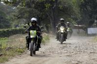 Colombian police patrol near the Tienditas International Bridge that connects Colombia and Venezuela, on the outskirts of Cucuta, Colombia, Wednesday, Feb. 6, 2019. Venezuelan authorities attempting to block humanitarian aid entering from Colombia have barricaded the key border crossing. (AP Photo/Fernando Vergara)