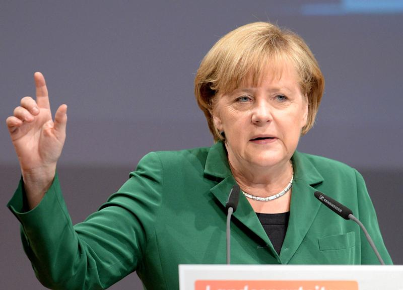 """German Chancellor Angela Merkel talks at an election campaign event in Heilbronn,Germany, Saturday Sept. 14, 2013. A state election Sunday in Bavaria gives Germany's politicians their last test before next week's national vote, with Chancellor Angela Merkel's conservative allies hoping to provide momentum with a big win in the prosperous region. It's hard to predict how the outcome in Bavaria might influence the Sept. 22 national election but governor Horst Seehofer, the leader of the Merkel-allied Christian Social Union, has pledged to """"sound the signal for victory nationwide."""" Polls suggest that his party, which has led Bavaria since 1957, can hope to win back an absolute majority in the state legislature it lost five years ago. (AP Photo/dpa, Bernd Weissbrod)"""