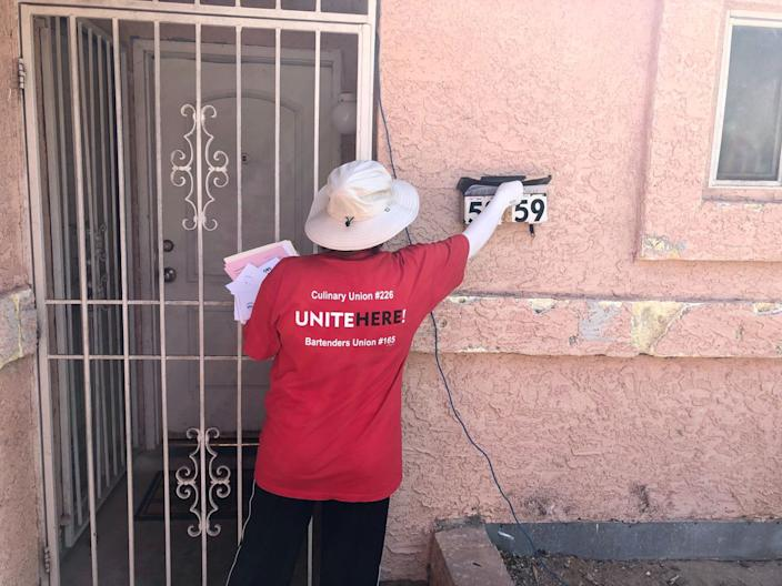 """Maria Magana leaves campaign literature at a home in Las Vegas. <span class=""""copyright"""">(Mark Z. Barabak / Los Angeles Times)</span>"""