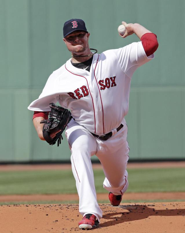 Boston Red Sox starting pitcher Jon Lester delivers against the Chicago White Sox during the first inning of a baseball game at Fenway Park in Boston, Thursday, July 10, 2014. (AP Photo/Charles Krupa)