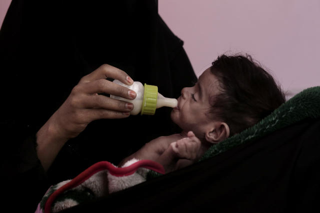 <p>Ahmed Rashid Mokbel, a severely malnourished 7-month-old Yemeni boy, is given formula by his mother at the Al-Sadaqa Hospital in Aden, Yemen, in this Feb. 13, 2018. The boy weighed only 3.3 kg (7 pounds). The Al-Sadaqa Hospital treats malnourishment cases from across southern Yemen _ those that are lucky enough to get there. Often families in towns and villages can't afford the trip to Aden and do what they can at home as their starving children deteriorate. (Photo: Nariman El-Mofty/AP) </p>