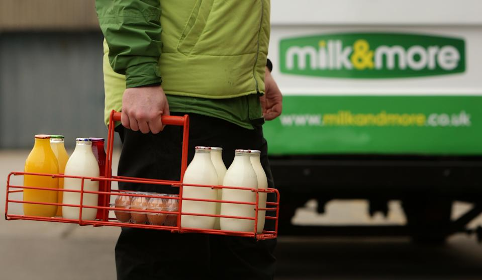 Dairy Crest milkman Tony Stevens delivers milk and other produce to a house in Greater Manchester.   (Photo by Dave Thompson/PA Images via Getty Images)