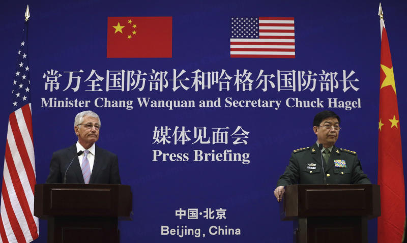 U.S. Defense Secretary Chuck Hagel, left, and Chinese Defense Minister Chang Wanquan participate in a joint news conference at the Chinese Defense Ministry headquarters in Beijing, China Tuesday, April 8, 2014. The defense chiefs of China and the U.S. faced off Tuesday over Beijing's escalating territorial disputes in the region, as Hagel, wagging his finger, said China doesn't have the right to unilaterally establish an air defense zone over disputed islands with no consultation. (AP Photo/Alex Wong, Pool)