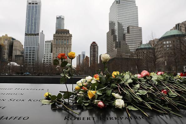 Flowers are placed on the names inscribed on the north reflecting pool of the National September 11 Memorial for those killed in the Feb. 26, 1993 truck bomb attack at the World Trade Center in New York City on the 25th anniversary of the bombing. (Photo by Spencer Platt/Getty Images)