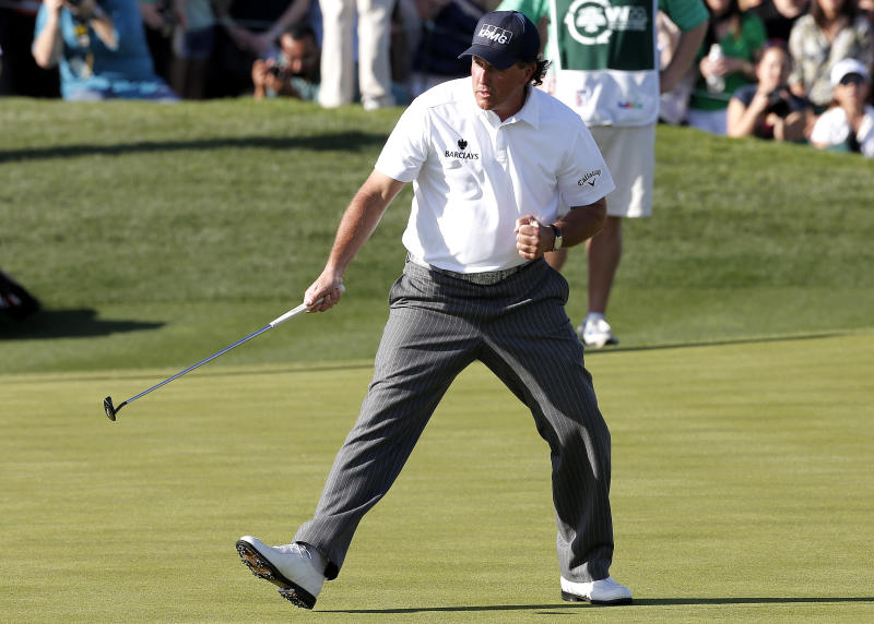 Phil Mickelson watches his birdie putt drop on the 18th green during the third round of the Waste Management Phoenix Open golf tournament on Saturday, Feb. 2, 2013, in Scottsdale, Ariz. (AP Photo/Matt York)