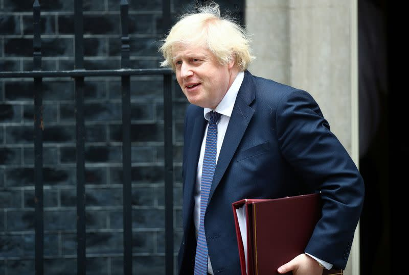 Behave yourselves, UK PM Johnson warns as pubs get ready to pull pints again