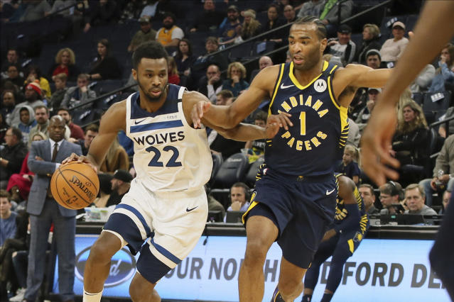 Minnesota Timberwolves' Andrew Wiggins, left, drives against Indiana Pacers' T.J. Warren in the first half of an NBA basketball game Wednesday, Jan. 15, 2020, in Minneapolis. (AP Photo/Jim Mone)
