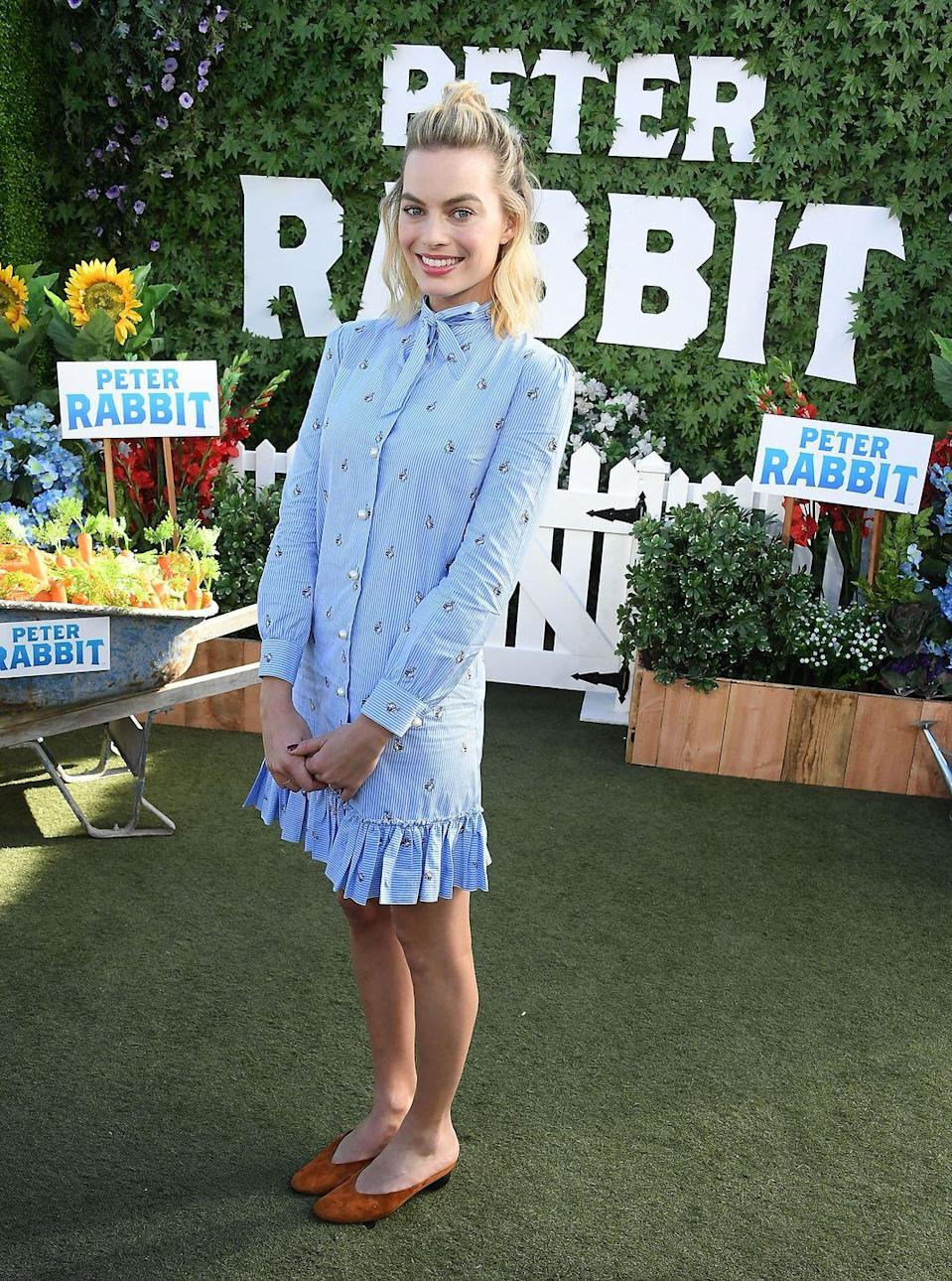 <p>The star wore a blue Gucci shirt dress to the Peter Rabbit premiere in LA.</p>