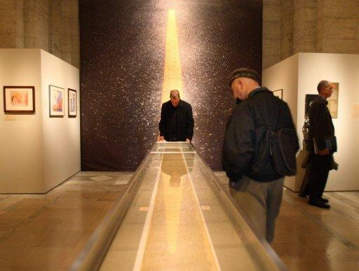 "Spectators view a 60 foot section of the  120 foot ""On the Road"" scroll in 2007"