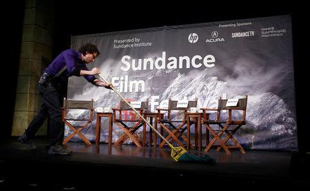Kevin Kane prepares the stage at an opening day news conference for the Sundance Film Festival in Park City, Utah, in this January 22, 2015 file photo.  REUTERS/Jim Urquhart/File Photo