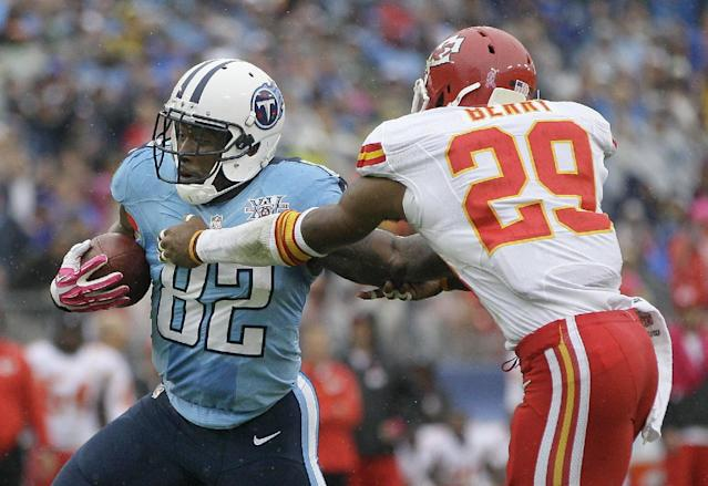 Tennessee Titans tight end Delanie Walker (82) is stopped by Kansas City Chiefs safety Eric Berry (29) after a 15-yard gain in the second quarter of an NFL football game on Sunday, Oct. 6, 2013, in Nashville, Tenn. (AP Photo/Wade Payne)