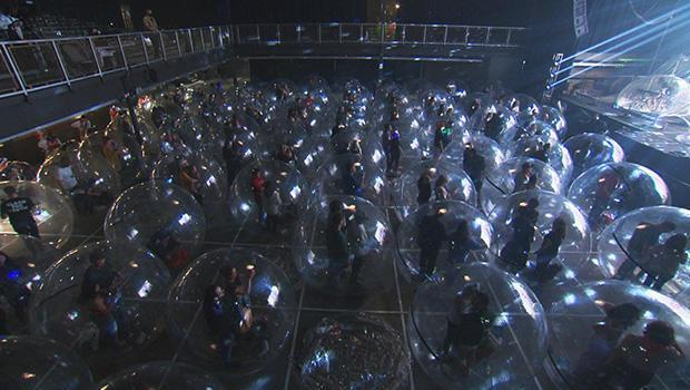 A socially-distanced audience (dramatically so) attends a Flaming Lips concert.  / Credit: CBS News