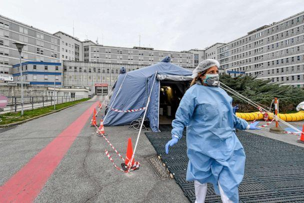 PHOTO: In this file photo taken on Feb. 29, 2020, a paramedic walks out of a tent that was set up in front of the emergency ward of the Cremona hospital in northern Italy. (Claudio Furlan/Lapresse via AP)