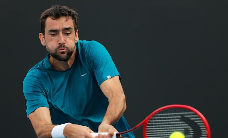 Croatia's Marin Cilic makes a backhand return to France's Corentin Moutet during their first round singles match at the Australian Open in Melbourne, Australia. AP